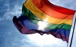 Rainbow_flag_and_blue_skies-356x236
